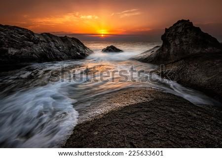 Sea sunrise at the Black Sea coast near Rezovo, Bulgaria - stock photo