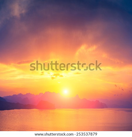 Sea sunrise with beautiful reflection of sun light in water - stock photo