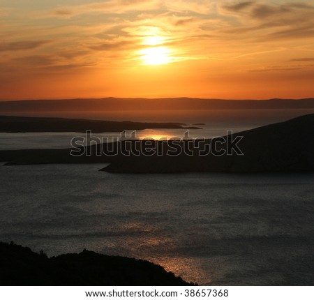 sea sunset above the islands - stock photo