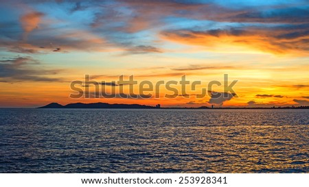Sea sunset and mountain - stock photo