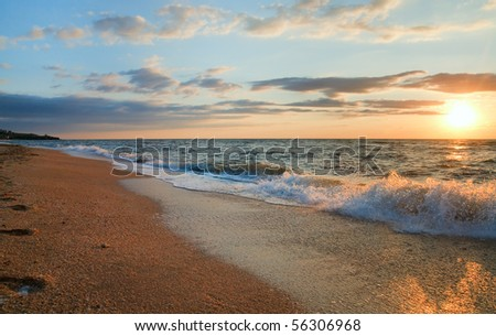 Sea  sunset surf great wave break on sandy coastline - stock photo