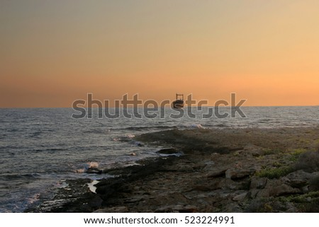 Sea sunset view. Stone shore of the Mediterranean Sea, Cyprus.
