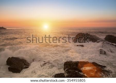 Sea surf during the stunning sunset. - stock photo