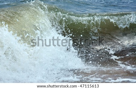 Sea surf great wave break on coastline (nature background)