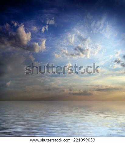 sea surface under solar dark sky - stock photo