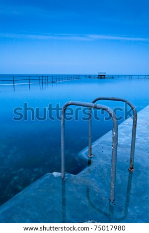 Sea swimming-pool at a tranquil blue sunset