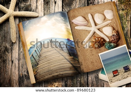 Sea tematic book on wooden background