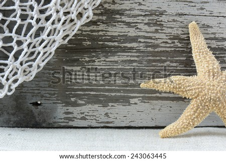 Sea Themed Background with Rustic Wood and  Fishing Net - stock photo