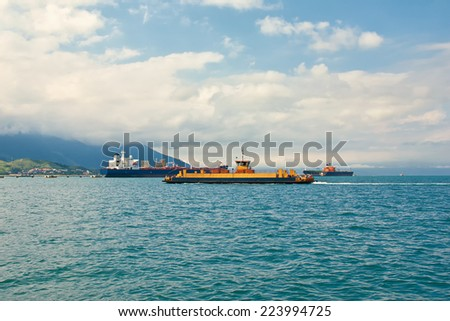 Sea transports - Ferryboat crossing in Brazil transporting vehicles and people - stock photo