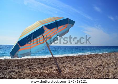 sea umbrella beach - stock photo