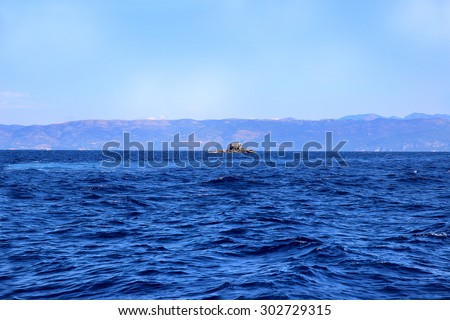 Sea view. Mountain view. View on Albania mointains. Beautiful Ionian dark blue sea. Lonely little rock in the middle of the sea