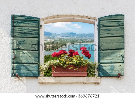 Sea view through the open window with flowers in Italy - stock photo