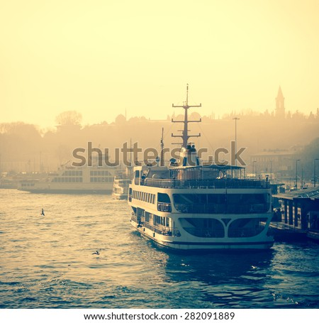 Sea voyage on Bosporus - traditions water transport of Istanbul. Silhouettes of turkish steamboat in Istanbul at sunset. Vintage passenger ship with soft light effect - travel concept in retro style. - stock photo