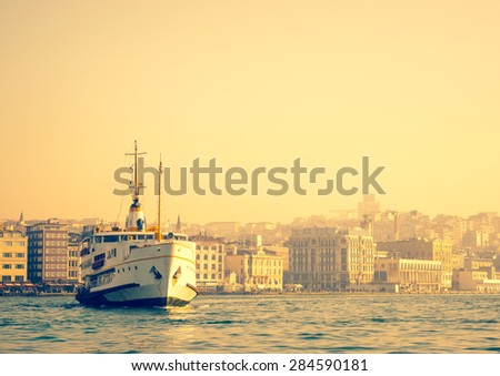 Sea voyage to Bosporus on the old ferryboat, Istanbul's water transport. Turkish steamboat in Golden Horn at sunset. Vintage passenger ship - travel concept of Turkey, soft light effect. - stock photo