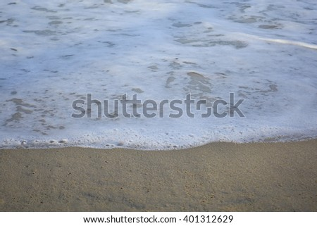 Sea water and beach with lighting in the morning:Close up,select focus with shallow depth of field:ideal use for background.