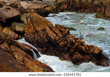 sea water bay with stony shore - stock photo