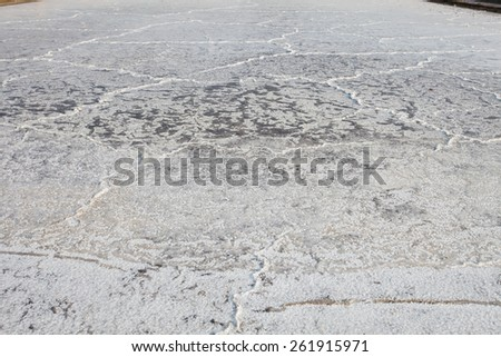 sea water on dirt in salt farm become to be salt  after past processing sun burn several day this is one of one processing to produce salt for consumption - stock photo