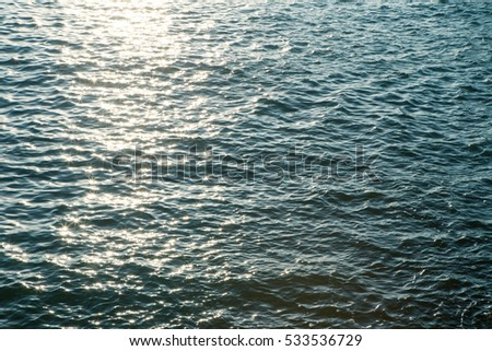 Sea water surface with sparkling sun light in evening