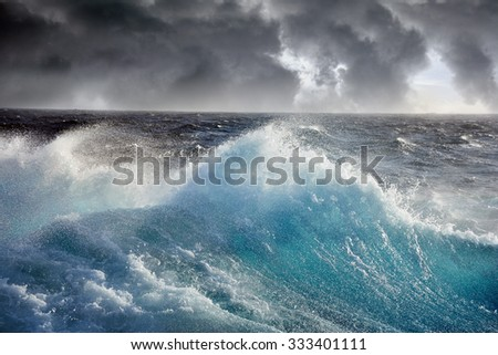 sea wave and dark cloudes on background - stock photo