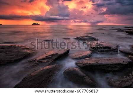 Sea wave and rocks with sunset light in the Cloudy day.Bang Ben beach,Ranong.Thailand.