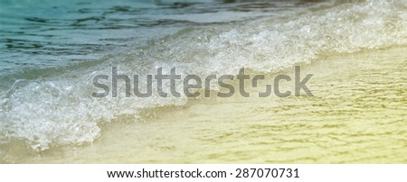Sea wave and sand  close up