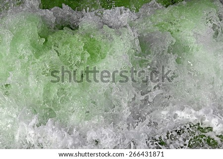Sea wave bubbles and splashes closeup view  - stock photo