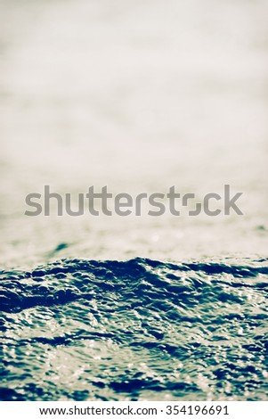 sea wave close up, low angle view, cross processing effect - stock photo