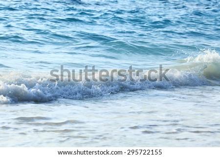 sea wave coast surf foam blue background - stock photo