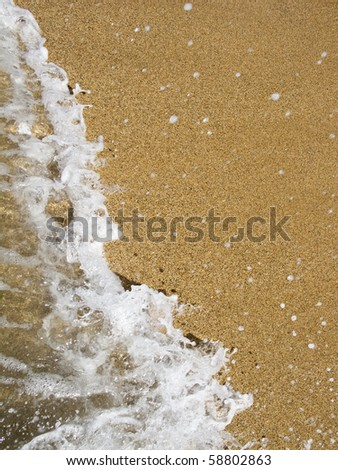 sea wave coming to the sand - stock photo