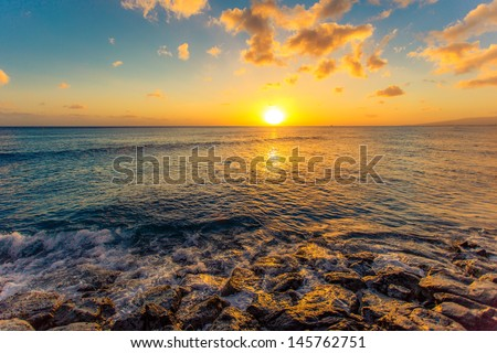 Sea wave hit the rock at sunset in Hawaii  - stock photo