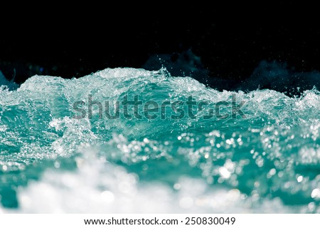 sea wave on a black background - stock photo