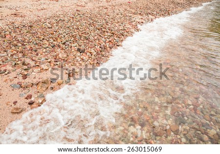 Sea wave on stone beach