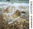 sea wave on the beatiful rock - stock photo