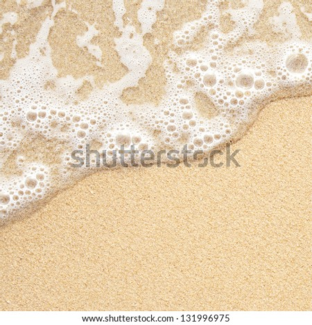 Sea wave over sand - stock photo