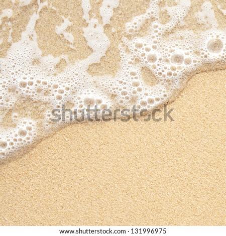 Sea wave over sand - stock photo