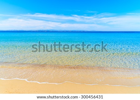 Sea wave with crystal clear azure water on beautiful sandy beach Grande Sperone, Corsica island, France - stock photo