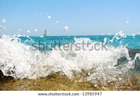 Sea wave with splash of water - stock photo