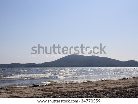 Sea waves and beach. - stock photo