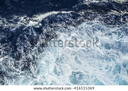 Sea waves and foam from a cruise ship - stock photo