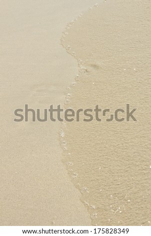 Sea waves and sand beach - stock photo