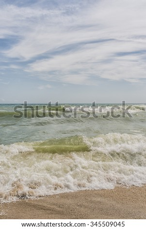 Sea waves and sand beach for texture or background. The flow of water