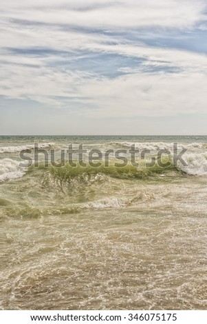 Sea waves and sand beach for texture or background. The flow of water.