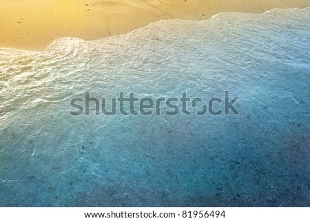 Sea waves background with golden sand and foam ocean water - stock photo