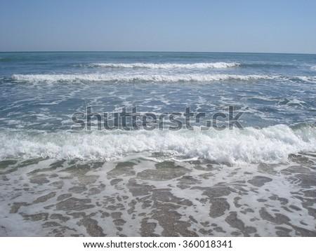 Sea waves coming towards shore - stock photo