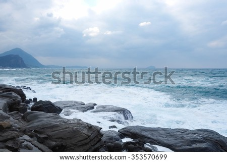 Sea waves crashing against the rocks
