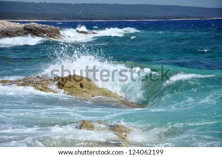 Sea waves crushing the shoreline, beautiful wild seascape - stock photo