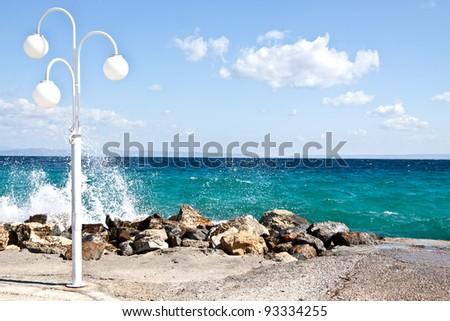 Sea waves fight about coastal stones - stock photo
