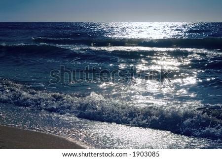 sea waves on beaches, sands, foam - stock photo