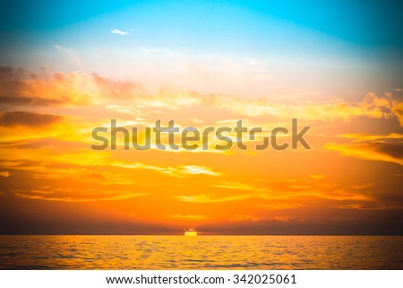 Sea waves on the background of beautiful sunset. Toned. - stock photo