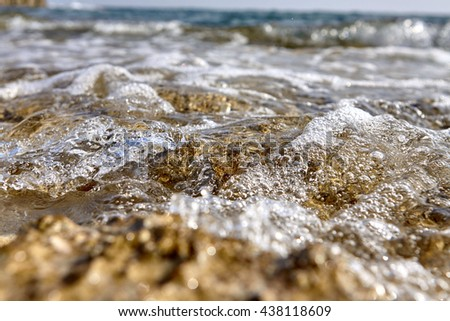 Sea waves on the beach with sunlight